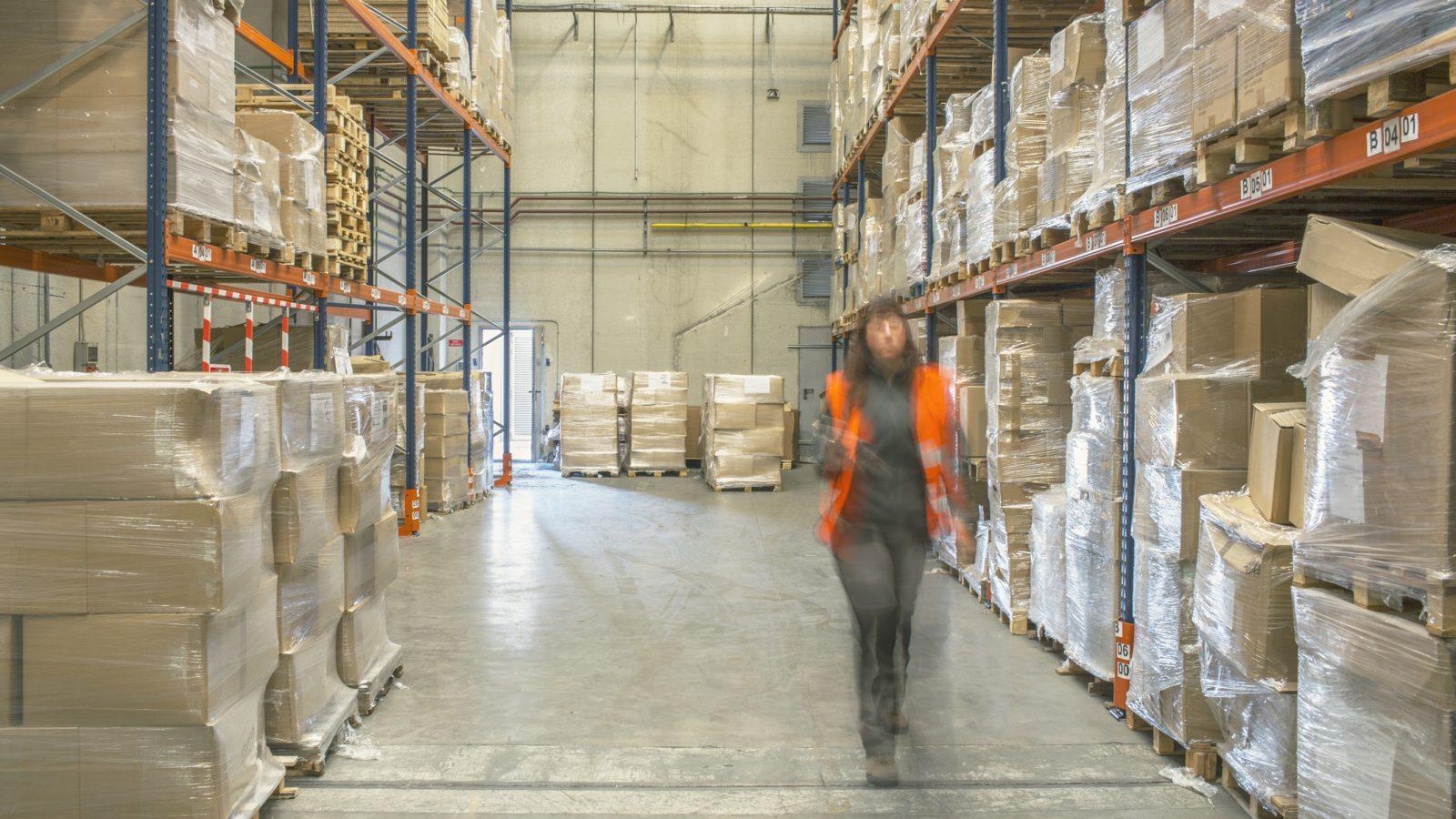 Warehouse worker motion blur